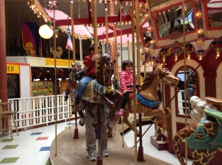 J loved this carousel. We would always have to stand by for support, but looking back now, I'm amazed. Her disease is cruel.