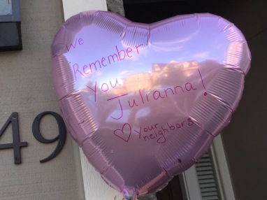 On the day of the tea party, our neighbors lined our street with pink balloons. This one was on our doorstep.